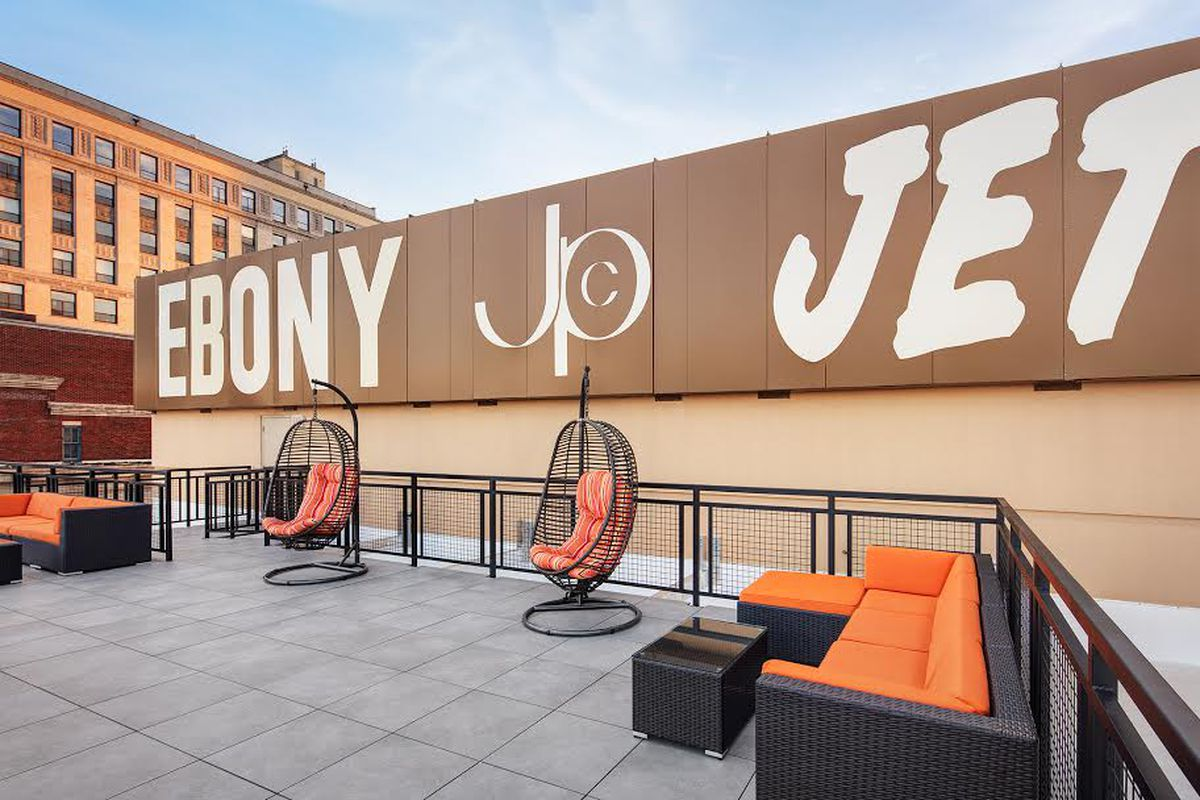Now apartments, Johnson Publishing sign on rooftop terrace a reminder of iconic history