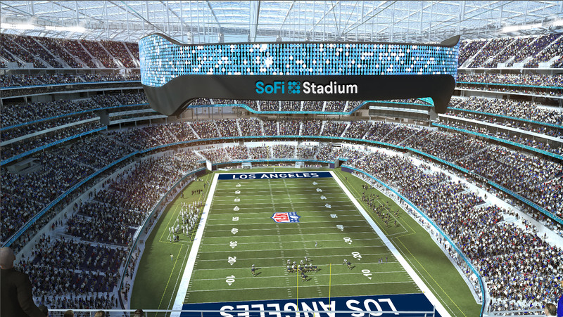 """A rendering of a football field. A display screen hangs from the roof, and the screen says """"SoFi Stadium."""""""