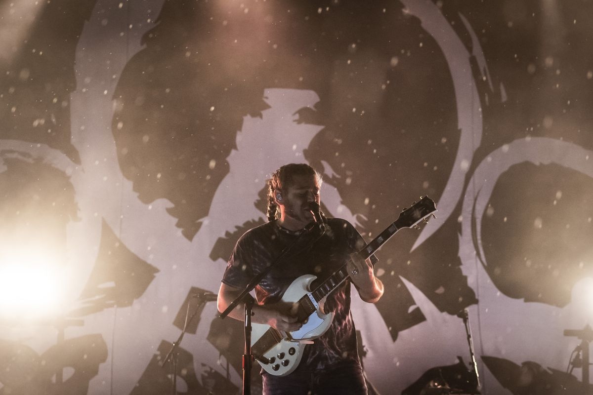 Coheed and Cambria performs in the rain Friday night at Riot Fest in Douglass Park.