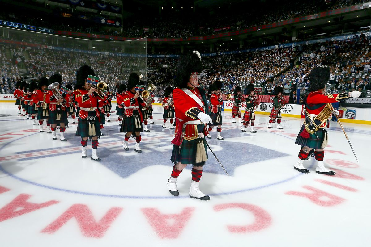 TORONTO, ON - OCTOBER 5: The 48th Highlanders take to the ice during the pre-game ceremony before NHL action between the Ottawa Senators and Toronto Maple Leafs during the home opener at the Air Canada Centre October 5, 2013 in Toronto, Ontario, Cana