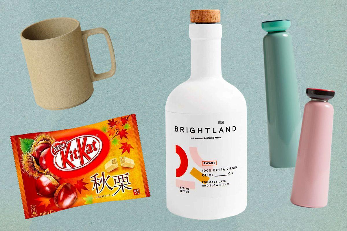 A mug, bag of Kit-Kats, bottle of Brightland olive oil, and two water bottles.
