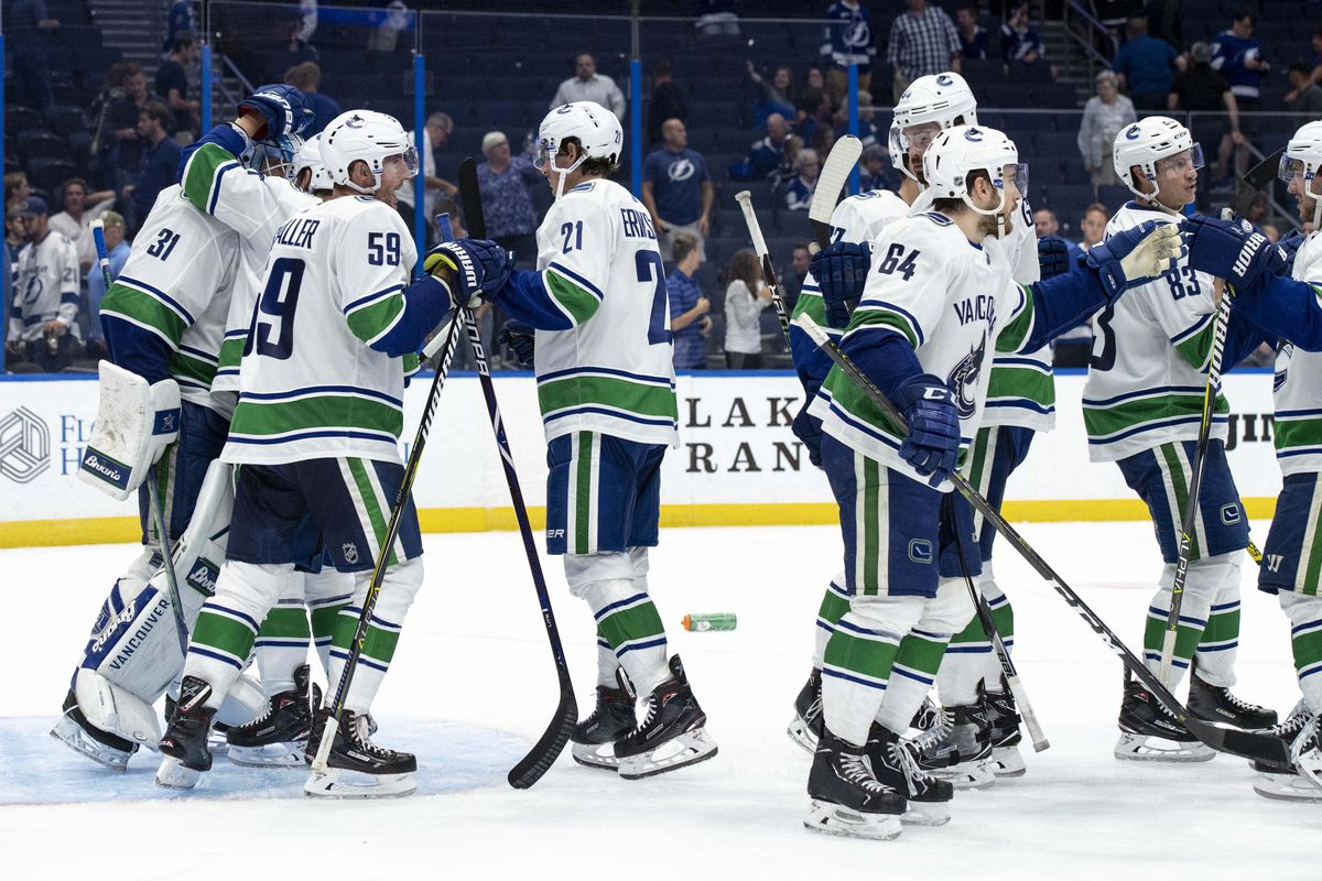 Oct 11, 2018; Tampa, FL, USA; Vancouver Canucks goalie Anders Nilsson (31) is congratulated by his teammates after the game between the Vancouver Canucks and Tampa Bay Lightning at Amalie Arena. Mandatory Credit: Douglas DeFelice