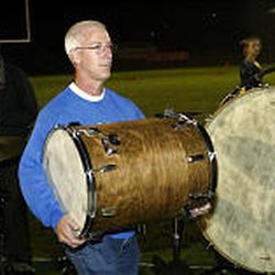 Tom Williams helps set up for halftime show at American Fork High.