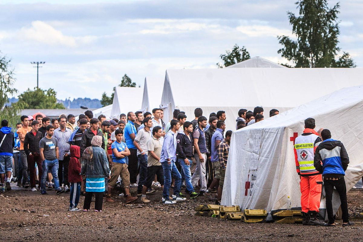 Refugees wait at a temporary Red Cross camp in Dresden, Germany.