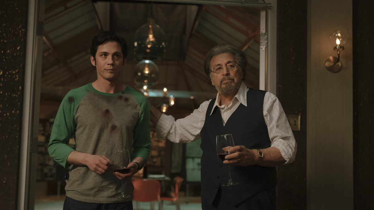 Jonah (Logan Lerman) and Meyer (Al Pacino) stand in the door way, the younger man with bullet wounds and the older man with a glass of wine
