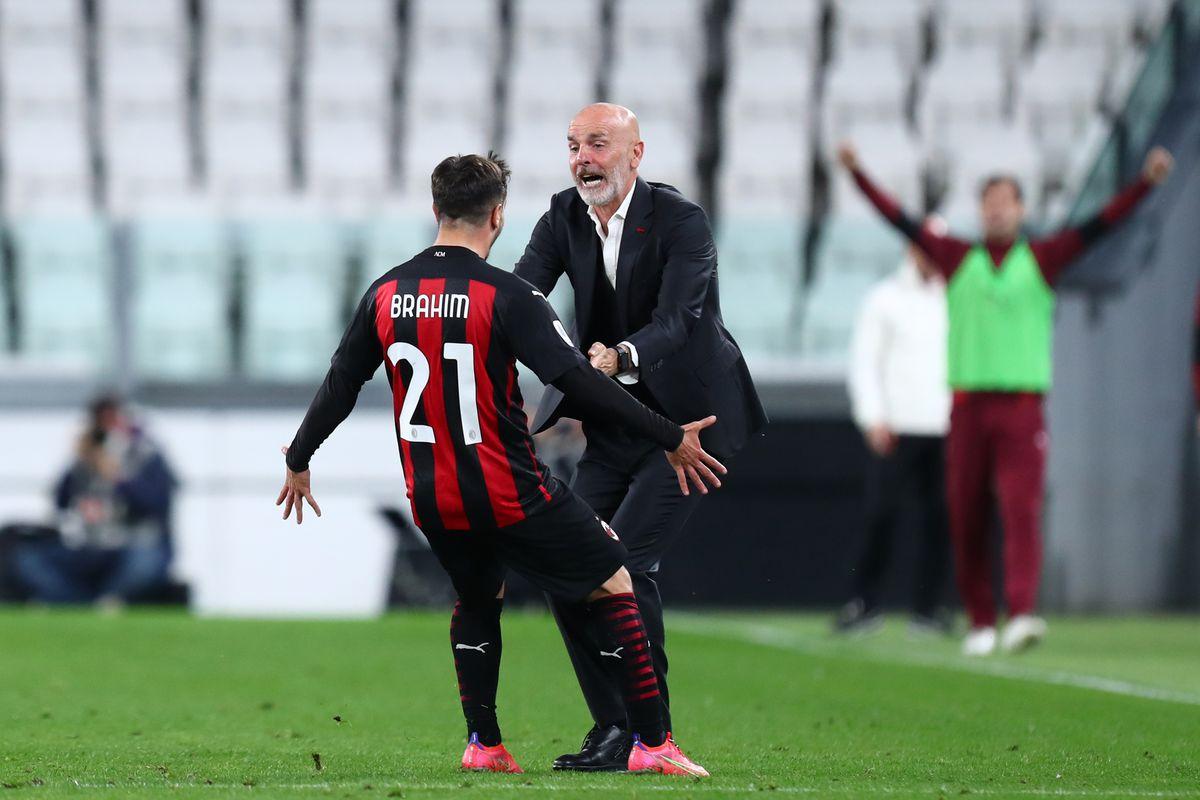 Brahim Diaz of Ac Milan (L) celebrate with his head coach...