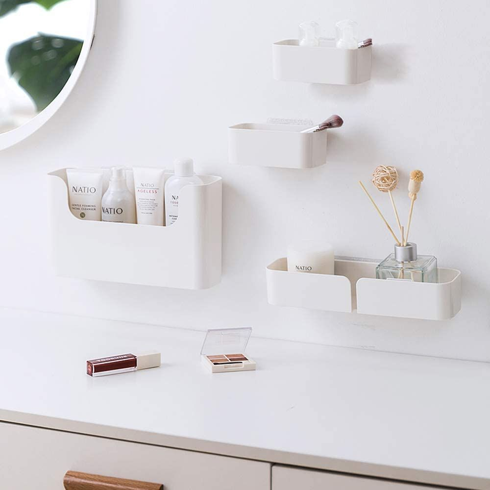 A wall with mounted white containers for holding objects.