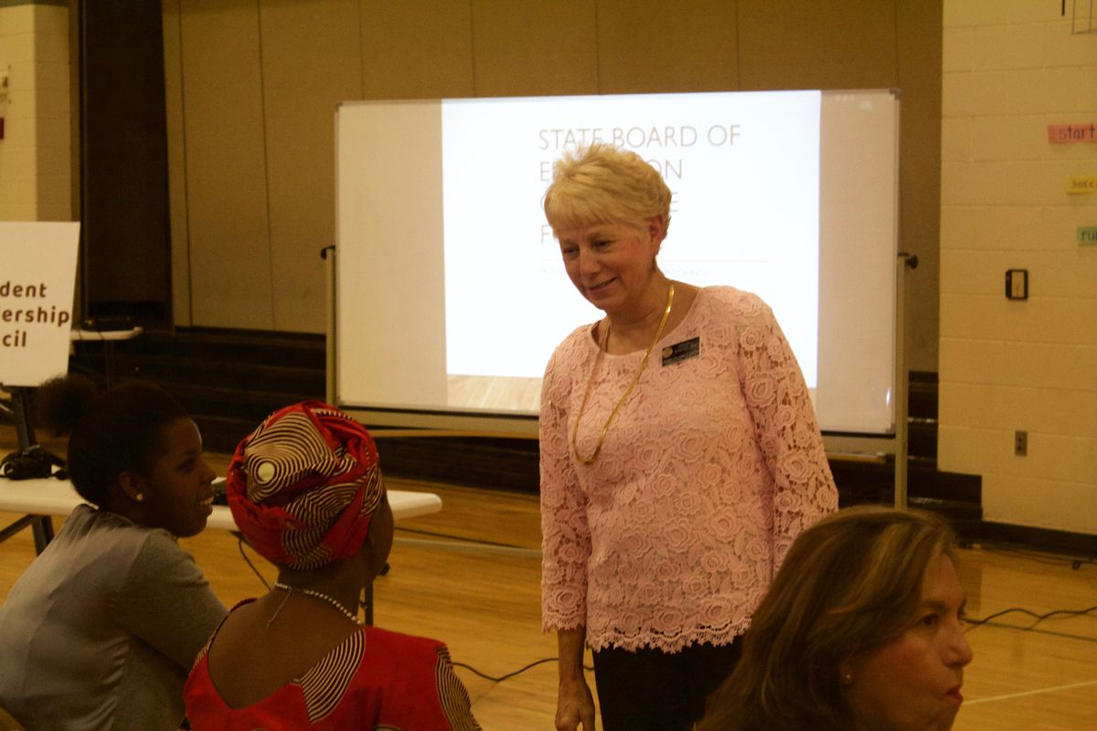 State Board of Education member Deb Scheffel meets with participants at an education forum in Aurora.