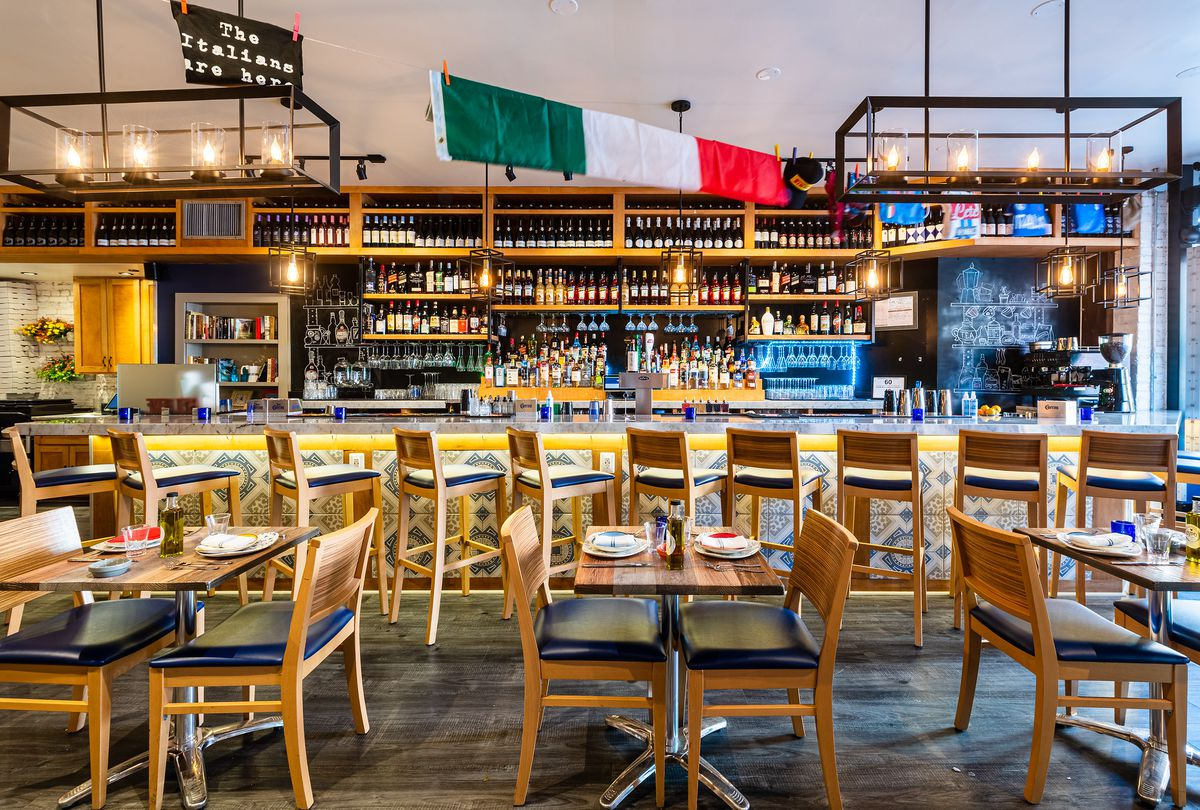 An Italian flag hangs over the bar at Lupo Pizzeria
