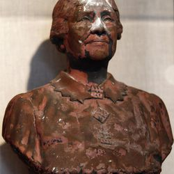 ADVANCE FOR USE SUNDAY, JULY 31, 2011 AND THEREAFTER - This Friday, June 24, 2011 photo shows a bust of Helen Keller scorched and covered in World Trade Center dust on display in New York. Besides ending nearly 3,000 lives, destroying planes and reducing buildings to tons of rubble and ash, the Sept. 11, 2001, attacks destroyed tens of thousands of records, irreplaceable historical documents and art. (AP Photo/Mary Altaffer)