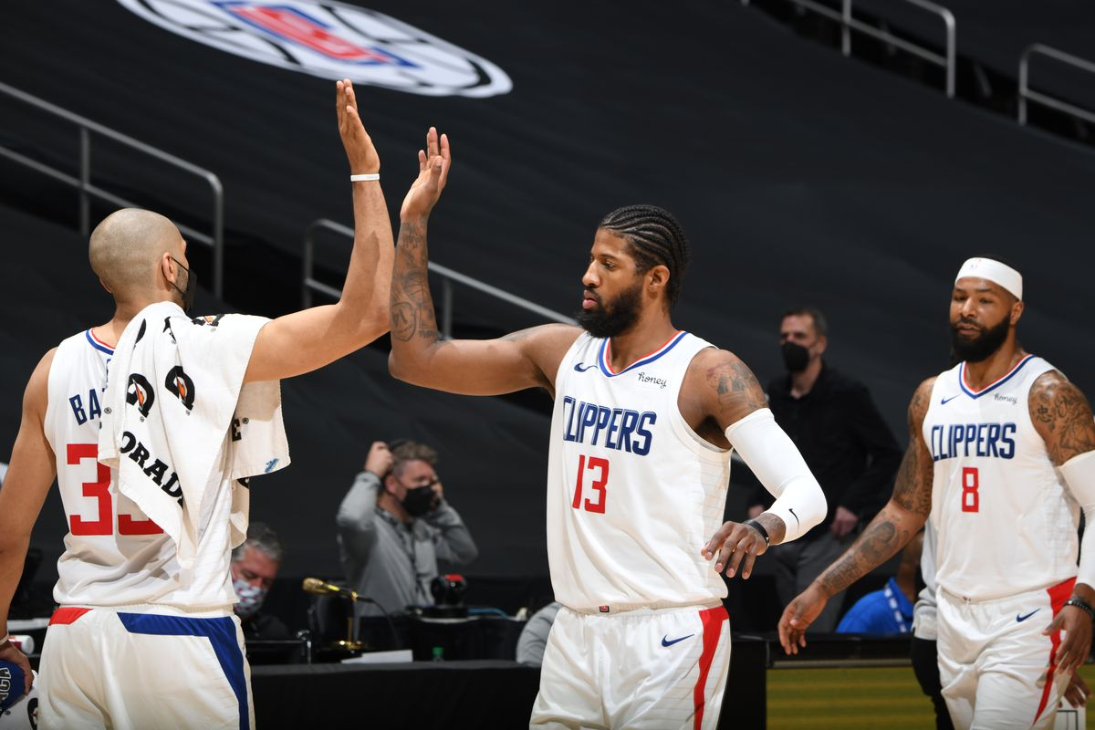 Paul George hi-fives Nicolas Batum of the LA Clippers during the game against the Washington Wizards on February 23, 2021 at STAPLES Center in Los Angeles, California.