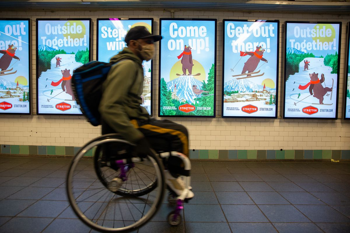 Saheed Adebayo Aare makes his way through the Times Square station to Port Authority during his three-hour commute from a Wards Island shelter to a New Jersey Amazon fulfillment center, Feb. 24, 2021.