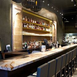 The bar is topped with an orange-rust marble