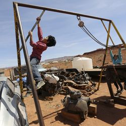 Jarett Hunt and Nesbah Hunt play outside of their home in Halchita, San Juan County, which is part of the Navajo Nation, on Friday, April 17, 2020. The Hunt siblings are asymptomatic but got tested earlier in the day to be safe, due to the high number of per capita COVID-19 cases in Navajo Nation.