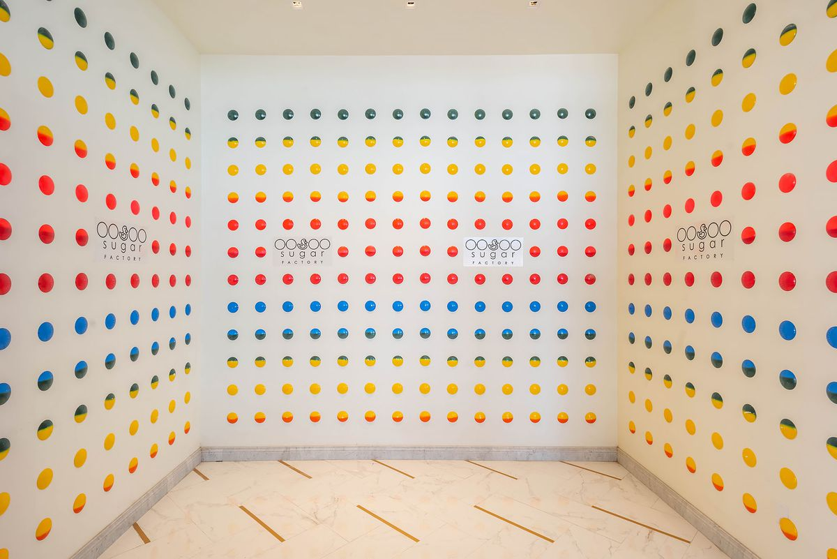 Colored dots in a line make up an art installation at a new restaurant.
