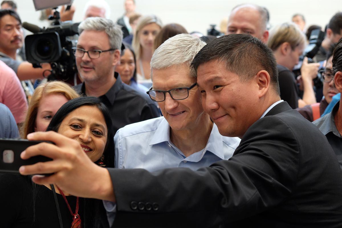 Apple CEO Tim Cook with guests, Steve Jobs Theater at Apple Park, iPhone X event, Sept. 12, 2017