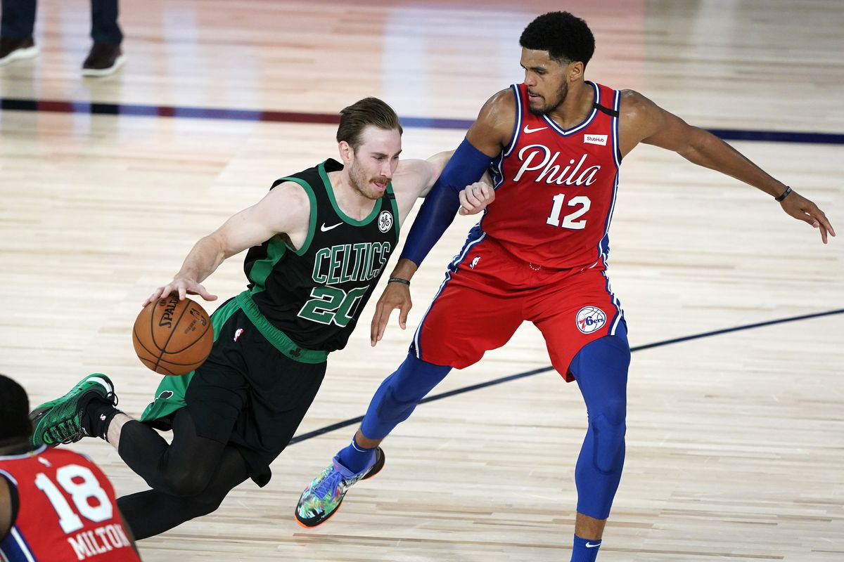 Gordon Hayward of the Boston Celtics drives against Tobias Harris of the Philadelphia 76ers during the first half at The Field House at ESPN Wide World Of Sports Complex on August 17, 2020 in Lake Buena Vista, Florida.