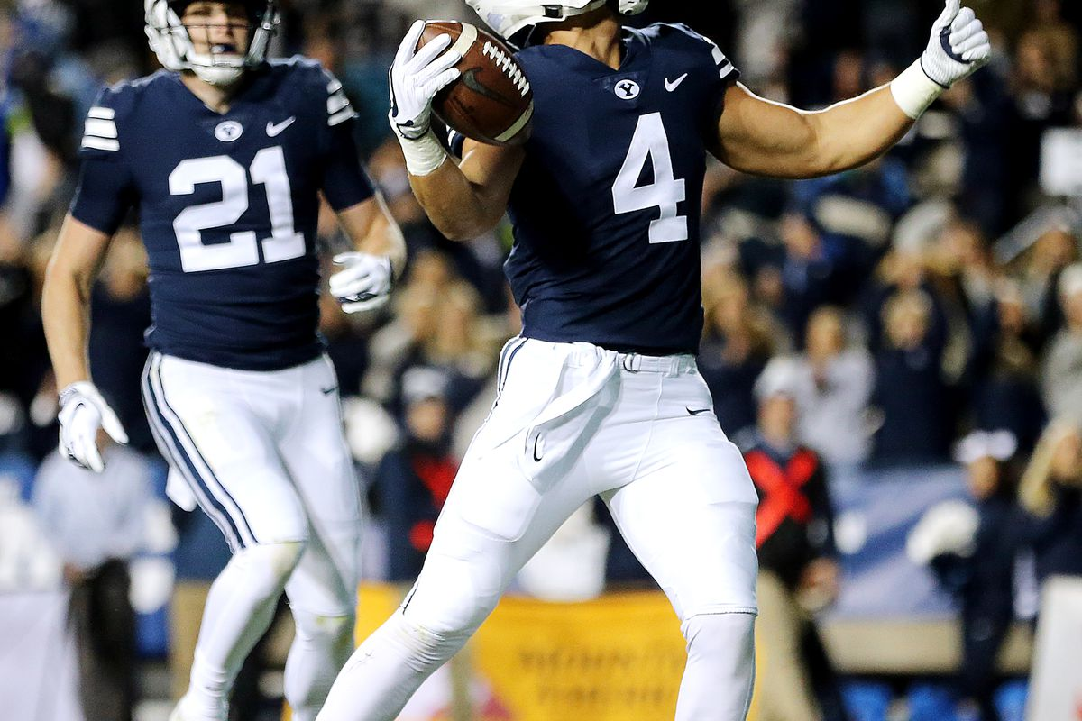 Brigham Young Cougars running back Lopini Katoa (4) celebrates a touchdown as BYU and Hawaii play at LaVell Edwards Stadium in Provo on Saturday, Oct. 13, 2018.