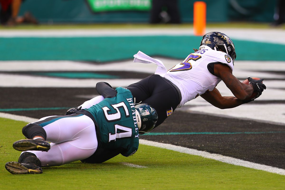 Gus Edwards #35 of the Baltimore Ravens scores a touchdown against Shaun Bradley #54 of the Philadelphia Eagles during the first quarter at Lincoln Financial Field on October 18, 2020 in Philadelphia, Pennsylvania.