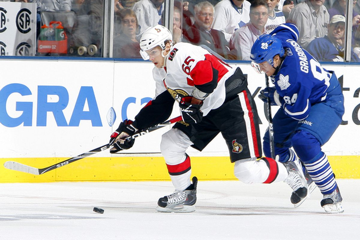 TORONTO - NOVEMBER 2:  Mikhail Grabovski #84 of the Toronto Maple Leafs chases Erik Karlsson #65 of the Ottawa Senators during NHL action at the Air Canada Centre November 2 2010 in Toronto Ontario Canada. (Photo by Abelimages/Getty Images)
