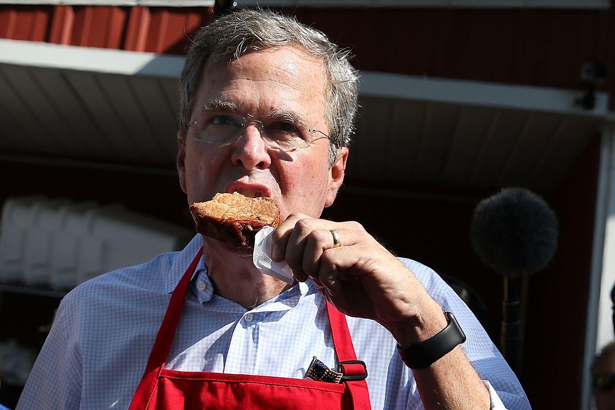 Republican presidential hopeful and Paleo acolyte Jeb Bush eating a pork chop.