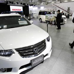 Honda's first quarter profits jumped 61 percent as the Japanese automaker sold more cars and motorcycles after a disaster-battered 2011.