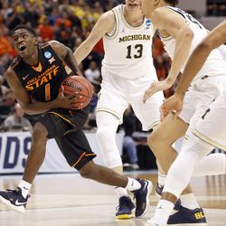 Oklahoma State's Jawun Evans (1) heads to the basket during the first half of a first-round game against Michigan in the men's NCAA college basketball tournament Friday, March 17, 2017, in Indianapolis. (AP Photo/Jeff Roberson)