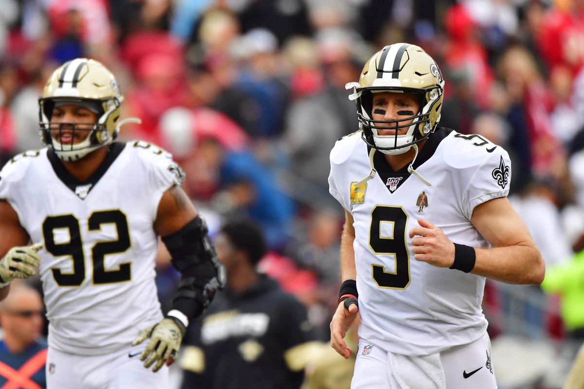 Drew Brees of the New Orleans Saints runs back out to the field during the third quarter of a football game against the Tampa Bay Buccaneers at Raymond James Stadium on November 17, 2019 in Tampa, Florida.