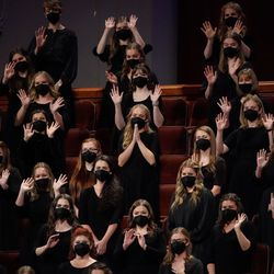 Members of a choir of BYU students wave after their performance during the Saturday evening session of the 191st Semiannual General Conference of The Church of Jesus Christ of Latter-day Saints at the Conference Center in Salt Lake City on Saturday, Oct. 2, 2021.