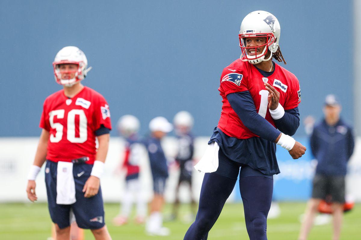 United States; New England Patriots quarterback Mac Jones watches New England Patriots quarterback Cam Newton during training camp at Gillette Stadium.