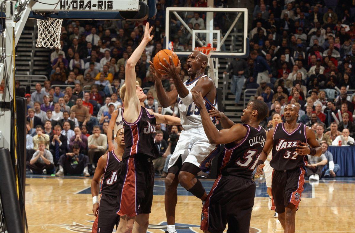 Jordan shoots between Kirilenko nd Collins