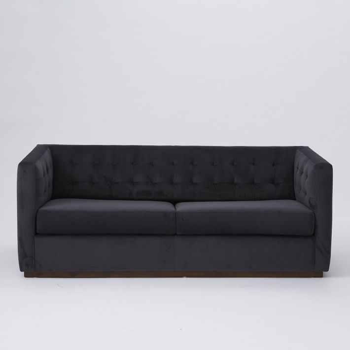 Charcoal-colored sofa.