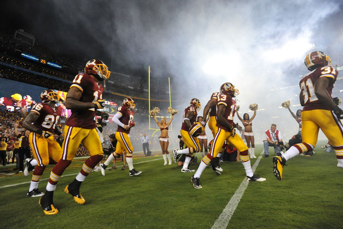LANDOVER - SEPTEMBER 12:  The Washington Redskins run onto the field before the NFL season opener against the Dallas Cowboys at FedExField on September 12 2010 in Landover Maryland.  (Photo by Larry French/Getty Images)