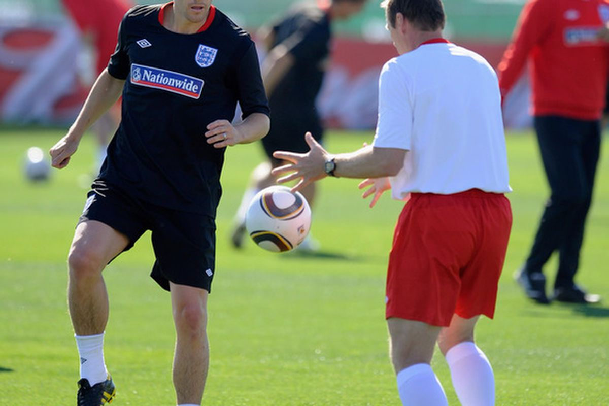 RUSTENBURG, SOUTH AFRICA - JUNE 06: Gareth Barry (L) kicks a ball during the England training session at the Royal Bafokeng Sports Campus on June 6, 2010 in Rustenburg, South Africa.  (Photo by Michael Regan/Getty Images)