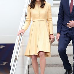 Arriving at Bhutan's Paro International Airport on April 14th, 2016 in a yellow Emilia Wickstead coatdress.
