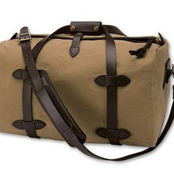 """<a href="""" http://www.filson.com/products/duffle-bag-small.70220.html?fromCat=true&fvalsProduct=luggage/carry-on&fmetaProduct=1019""""> Filson small dufflebag</a>, $225 filson.com"""