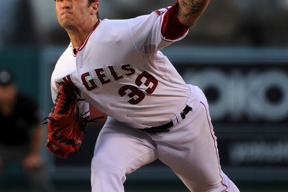 ANAHEIM, CA - AUGUST 18:  C.J. Wilson #33 of the Los Angeles Angels of Anaheim pitches against the Tampa Bay Rays at Angel Stadium of Anaheim on August 18, 2012 in Anaheim, California.  (Photo by Lisa Blumenfeld/Getty Images)