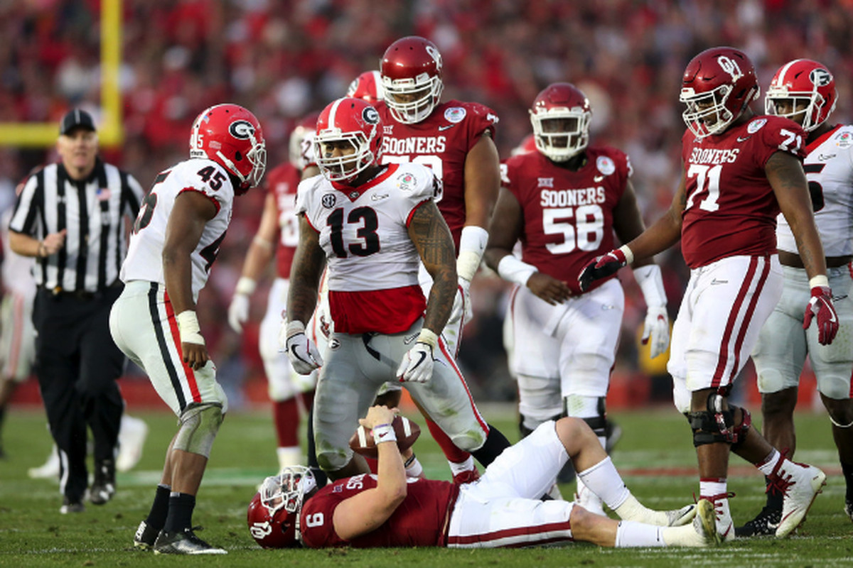 edcb64eed Oklahoma quarterback Baker Mayfield is sacked by Georgia defensive end  Jonathan Ledbetter in the second half of the Rose Bowl on Monday in  Pasadena
