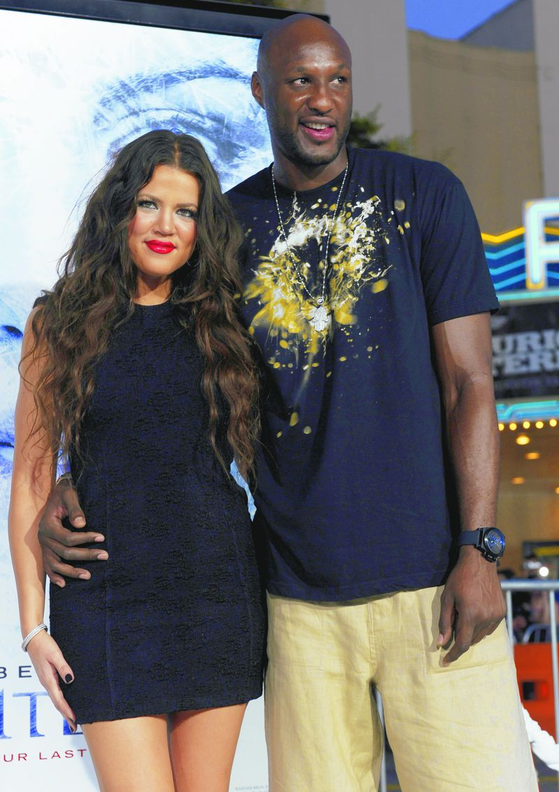 """Khloe Kardashian and Los Angeles Lakers basketball player Lamar Odom pose together at the premiere of the film """"Whiteout"""" in Los Angeles in 2009."""
