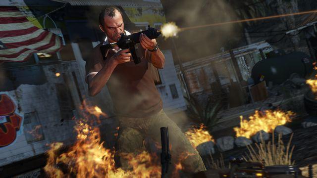 Grand Theft Auto 5 - Trevor firing a submachine gun with flames around him
