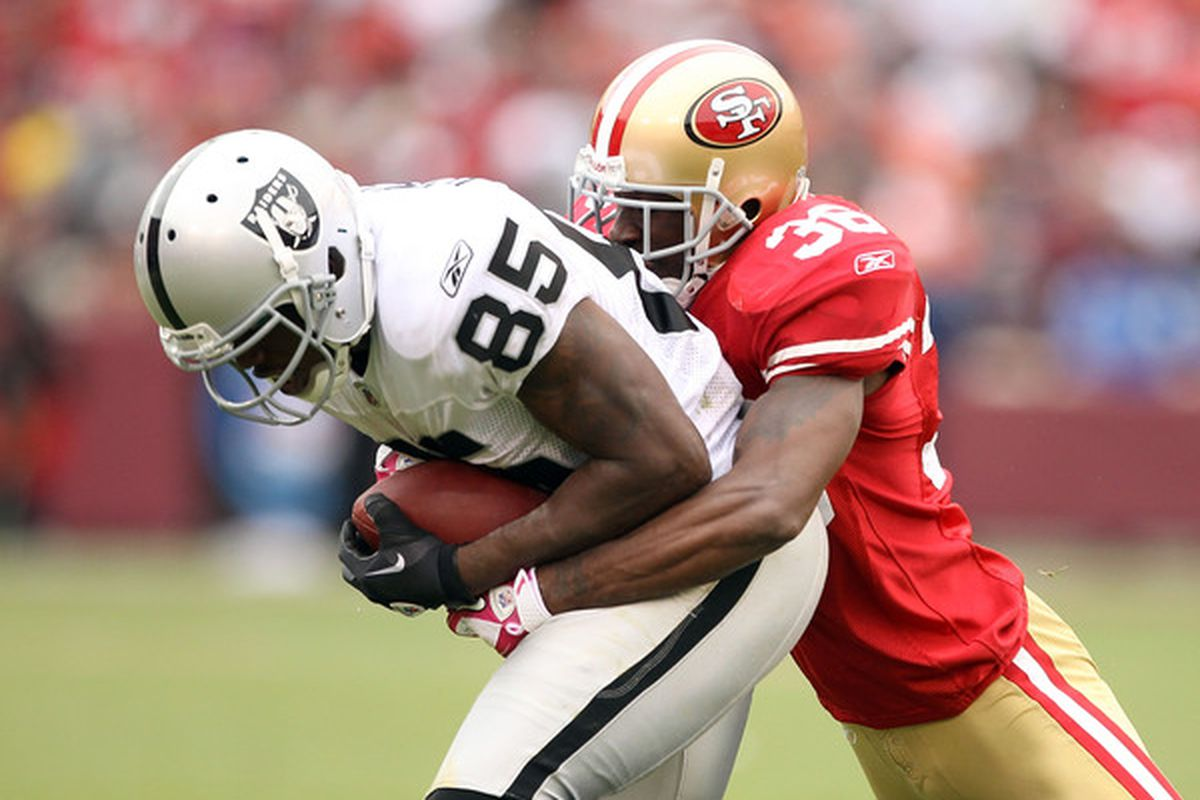 SAN FRANCISCO - OCTOBER 17:  Darrius Heyward-Bey #85 of the Oakland Raiders is tackled by Dashon Goldson #38 of the San Francisco 49ers at Candlestick Park on October 17 2010 in San Francisco California.  (Photo by Ezra Shaw/Getty Images)