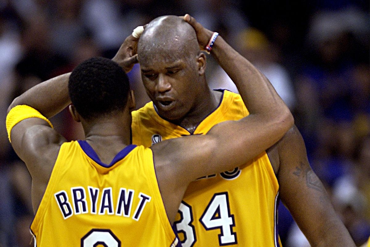 Lakers Kobe Bryant and Shaquille O'Neal congratulate each other during a game against the Trailblaze