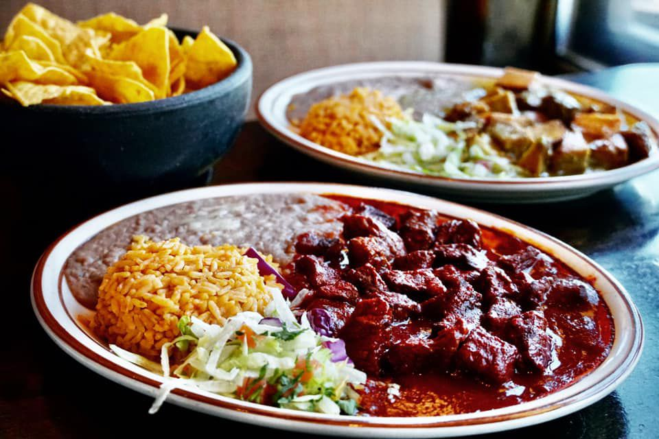 A plate of chile with rice and beans