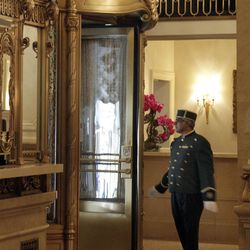 A doorman works in the lobby of New York's St. Regis Hotel, Wednesday, March 14, 2012. A century after the Titanic sank, the legacy of the ship's wealthiest and most famous passenger, John Jacob Astor, quietly lives on at the luxury hotel he built in New York City.