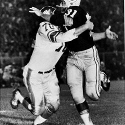FILE - In this Sept. 4, 1962, file photo, New York Giants' linebacker Sam Huff, left,  tackles Green Bay Packers' Jim Taylor (31) during an NFL football game in Green Bay, Wis. On Saturday, the 77-year-old Huff will be honored during West Virginia's NCAA college football game against James Madison of the Championship Subdivision.