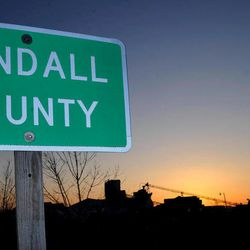 FILE - This March 19, 2008, file photo shows a Kendall County street sign in Oswego, Ill., about 50 miles west of Chicago. The nation's No. 1 fastest-growing county from 2000 to 2010, Kendall was part of an exurban wave in the heady 2000s that more than doubled Kendall's population. Now Census estimates as of July 2011 highlight a shift in population trends, following an extended housing bust and renewed spike in oil prices; outlying suburbs are now seeing their growth fizzle to historic lows, halting American city dwellers' decades-long exodus to sprawling homes in distant towns.