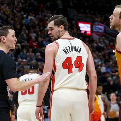 Utah Jazz guard Joe Ingles (2) talks to the referee while Portland Trail Blazers forward Mario Hezonja (44) stands between them during the game at Vivint Smart Home Arena in Salt Lake City on Friday, Feb. 7, 2020.
