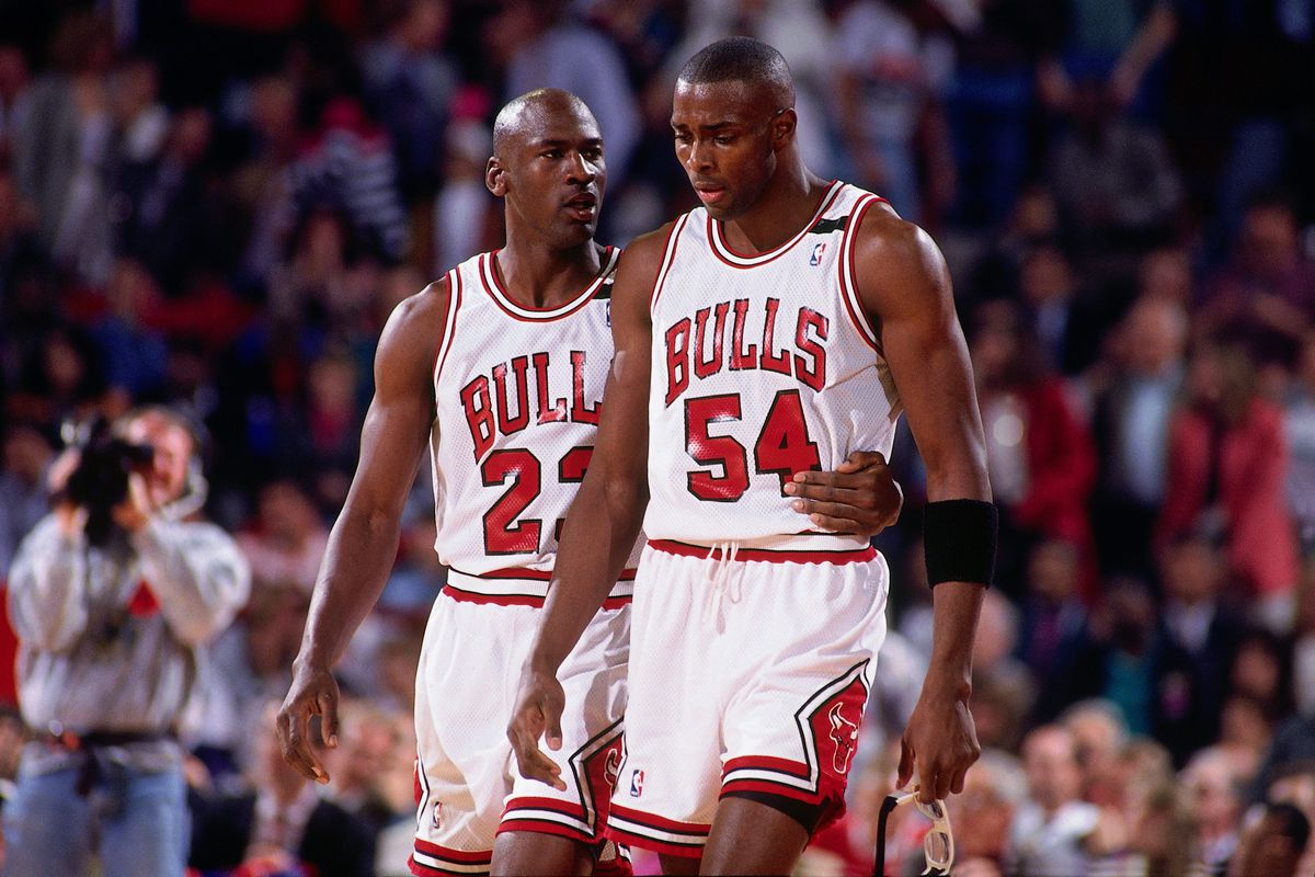 CHICAGO - MAY 19: Michael Jordan #23 comforts teammate Horace Grant #54 of the Chicago Bulls during Game One of the Eastern Conference Finals against the Cleveland Cavaliers played on May 19, 1992 at Chicago Stadium in Chicago, Illinois.