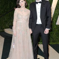 Zooey Deschanel, in Valentino, doesn't look psyched about this photo opp.