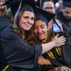 Salt Lake Community College graduates congratulate each other during the 2017 commencement ceremony at the Maverik Center in West Valley City on Friday, May 5, 2017.
